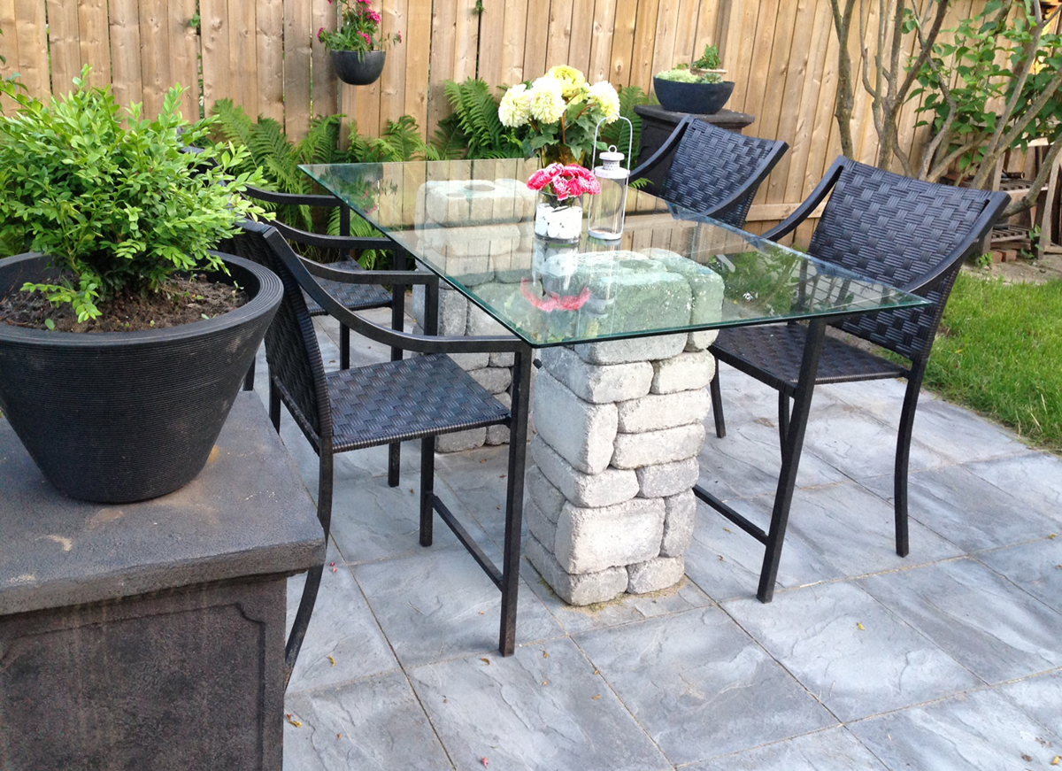 Backyard reno stone and glass top patio table for Glass top outdoor dining table