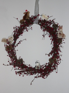 Wreath with large pine cones and critters added in.