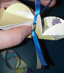 put the ribbon through the space before gluing.