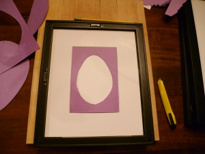 To be extra certain my egg shape was centered, I placed the white paper under the mat in the frame and then placed my stencil on top before drawing the egg on the white paper.
