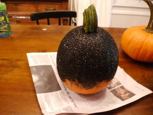 I let the glue dry and moved on to another pumpkin to keep the momentum going. This is when the multiple layers of newspaper on my work surface came in handy.